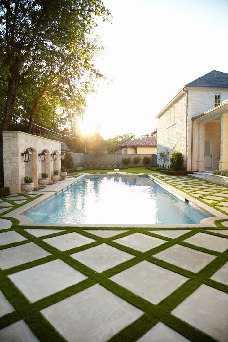Love The Grass Between The Pavers Around This Swimming Pool Saturn Pools Swimming Pool Landscaping Swimming Pools Backyard Backyard Pool Landscaping
