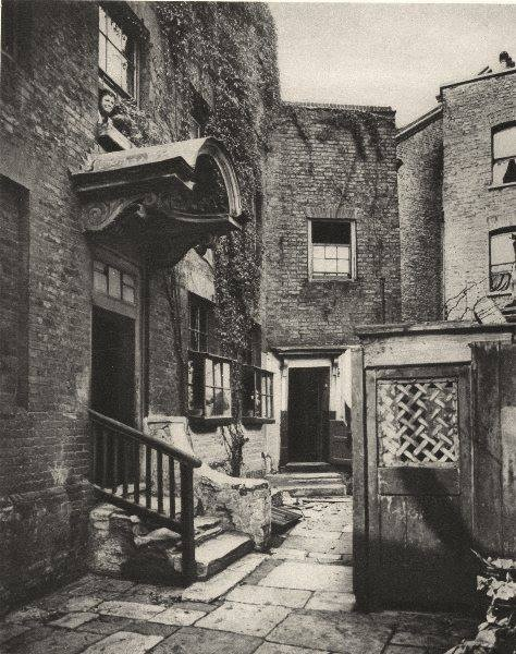 The building with the canopy is Bridge House, George Row, Bermondsey, in 1926. Built around 1705 and demolished in 1950, the place was once surrounded by the Jacob's Island rookery.