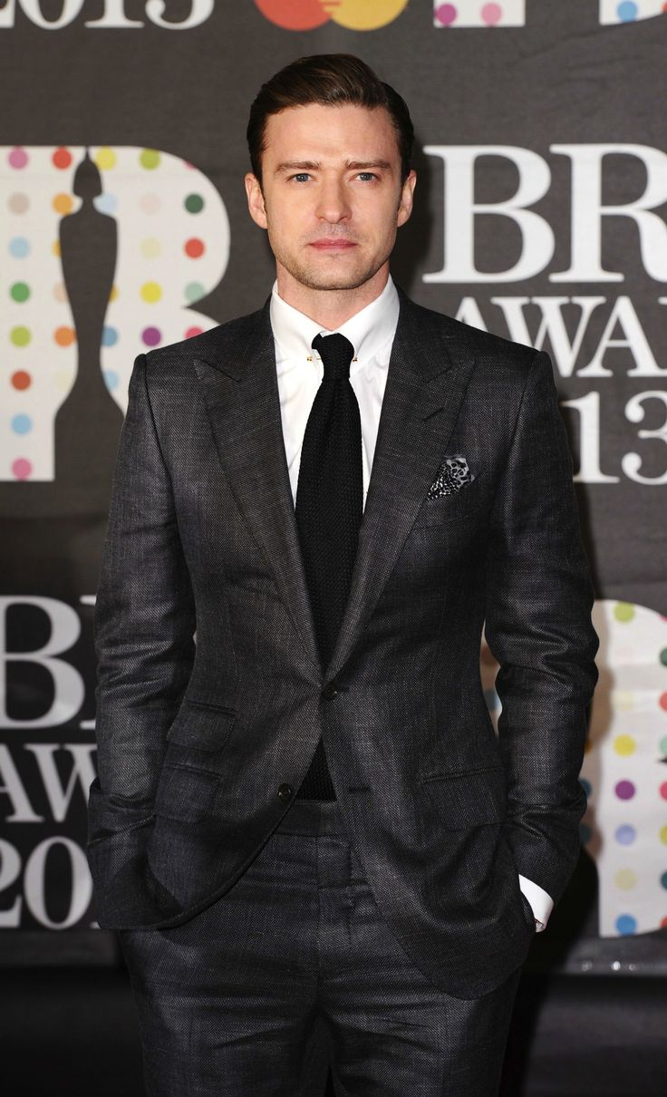 """JT at the 2013 Brit Awards In TOM FORD Charcoal Grey """"O'Connor"""" Sharkskin suit w/peak Lapels and ticket pocket. White classic collar shirt w/pin, black silk knit tie, and black/white silk pocket square."""