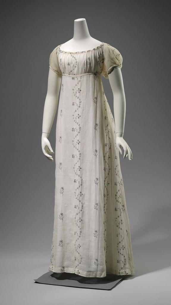 1810 ca. Cotton Dress. High waisted, low squared neckline, short puffed sleeves, cotton plain weave ( mull), embroidered with lengthwise silver strips. mfa.org suzilove.com
