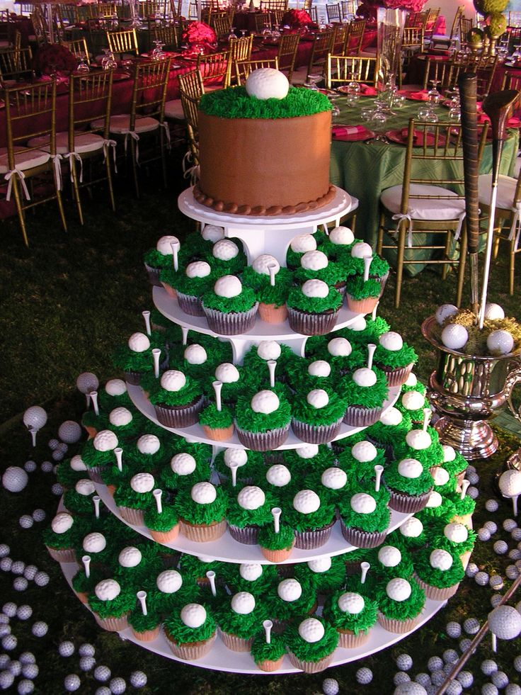 This is a 1 tier chocolate butter cream cake paired with cupcakes that has been iced to look like grass and topped with fondant golf ball and real golf tees!