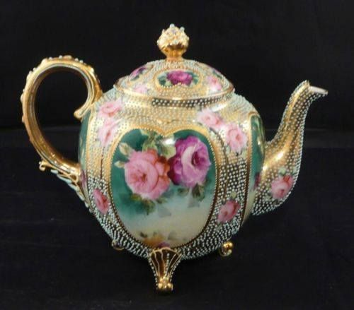 Nippon Teapot on feet. In Gold and Green with Cameos of Roses