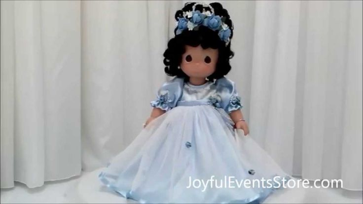 Precious Moments Dolls in Pink, White, and Blue