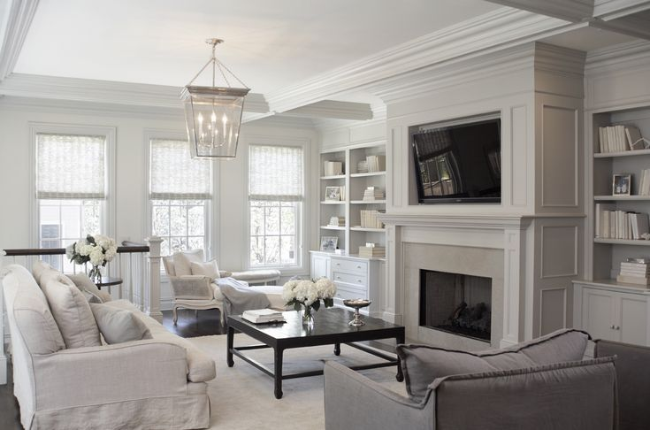 Leo Designs Chicago/So much white, but it certainly works!  I like the window shades used in this room as well.