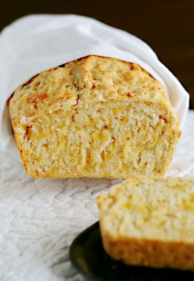 Cheesy Beer Bread Recipe is the perfect side kick to a hot bowl of chili or warm cup of soup from dineanddish.net