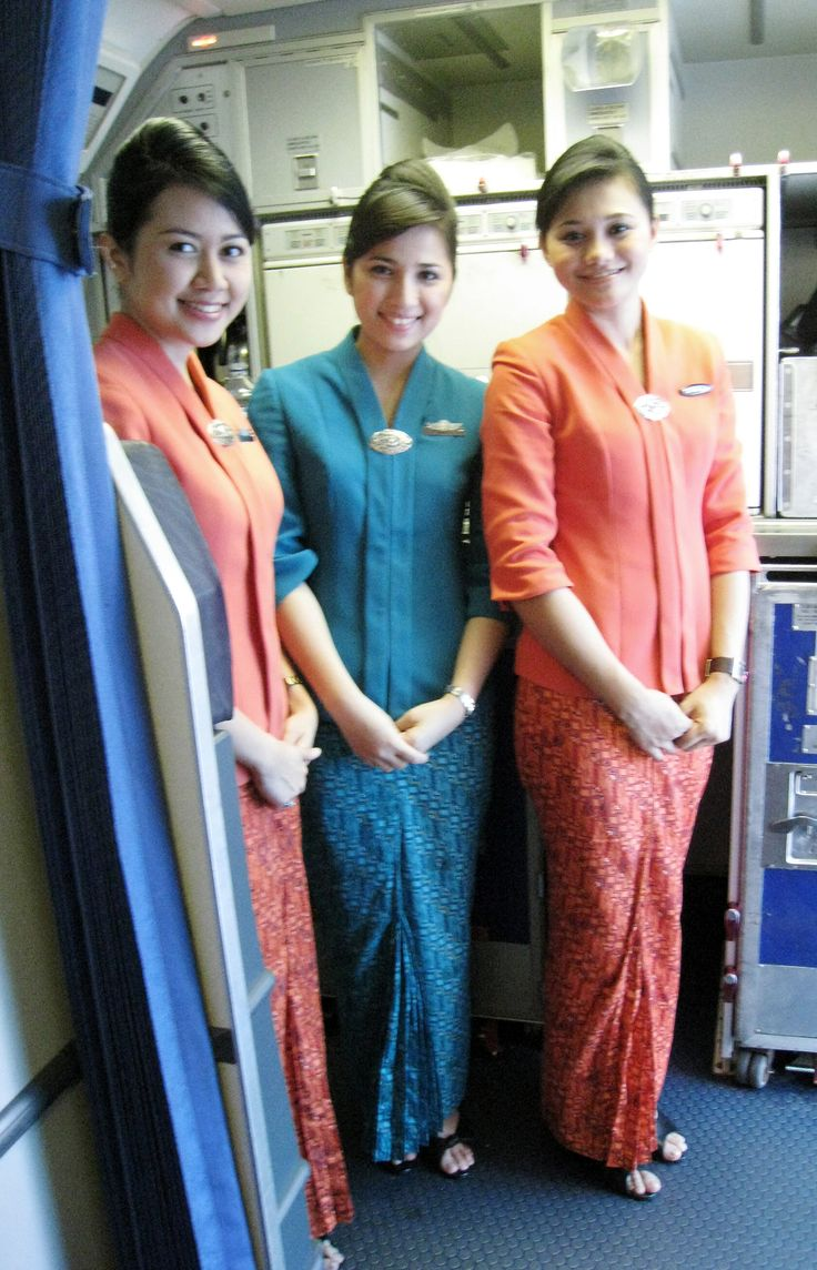 Indonesia flight attendants in their elegant new uniform (2010) featuring Kebaya and Batik, the national costume of Indonesia. The new in-flight costumes for Garuda Indonesia stewardesses are inspired by the traditional Kartini-styled kebaya for the upper torso with batik sarong.