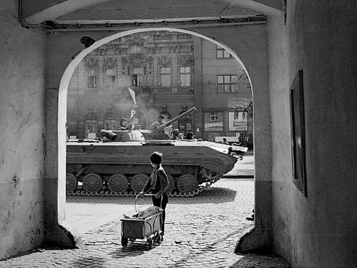 Czechoslovakia. A child watches as Warsaw Pact tanks invade his country,  August 1968