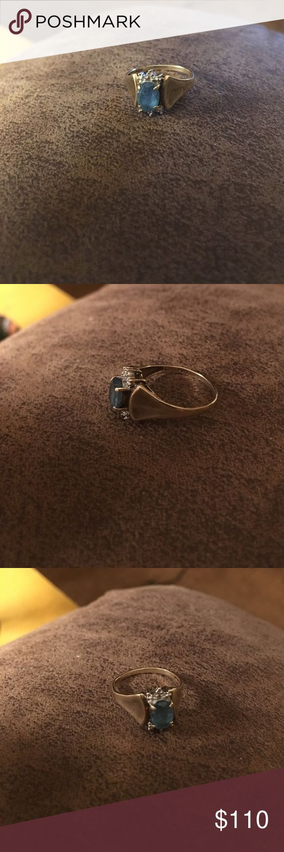 10K Gold 1 Carat Blue Topaz Diamond Ring 10 K gold 1 carat Blue Topaz both ends of blue topaz is edged in Diamonds 💎 size 6. Beautiful Ring. Jewelry Rings