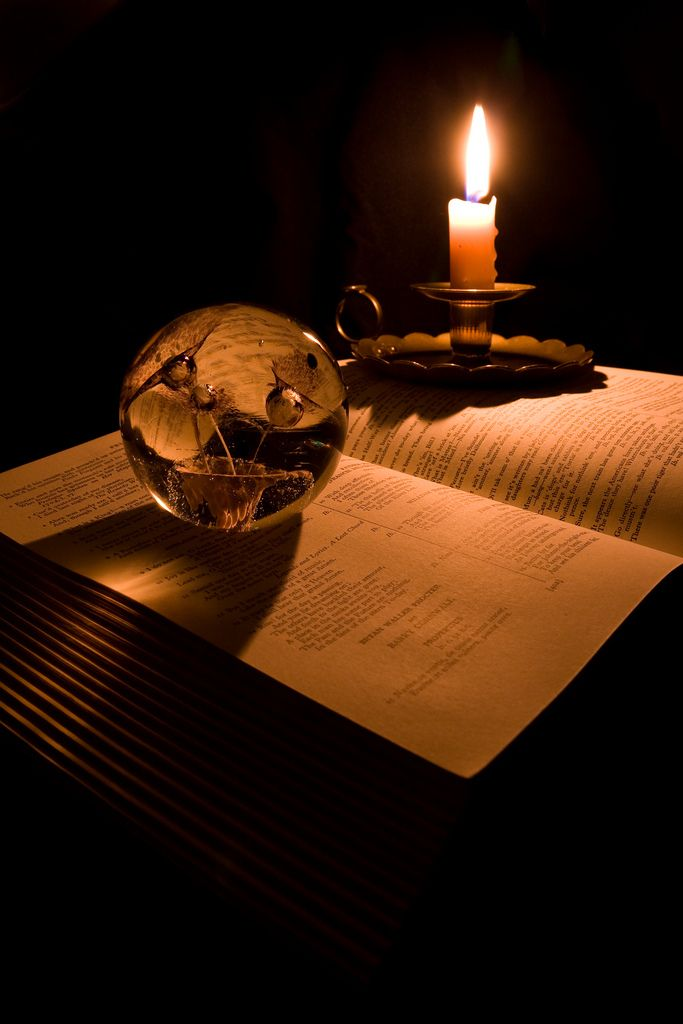Book, Candle and Paperweight.