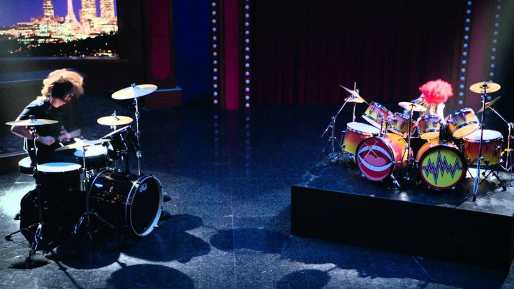 Dave Grohl and Animal Drum Battle - The Muppets  Oh my gosh I can't stop laughing!!!!! I love Animal!!!!