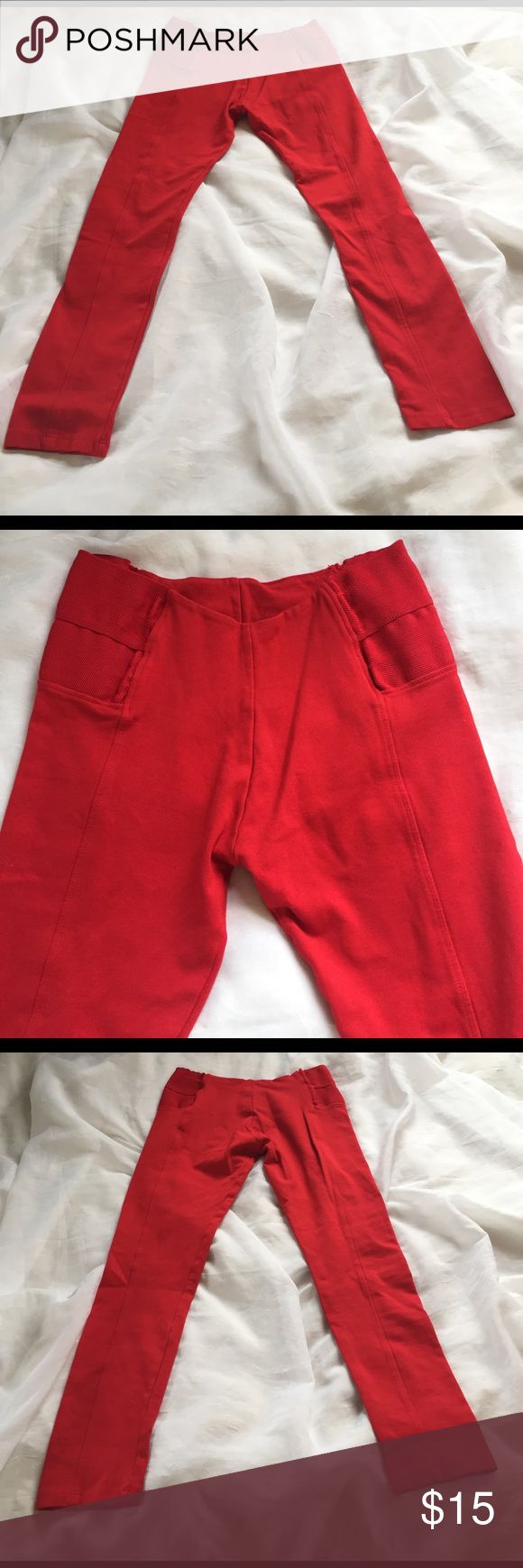 """🦊B2G1 Active USA red leggings, size med Bright red leggings in a size medium, by active USA. Thick material, with elastic hips. Waist is 28"""", with plenty of stretch, rise 9.5"""", inseam 26.6""""s some wear to elastic waist as pics show. 🦊 I do not model or trade. Please use measurements provided, and ask all questions prior to purchase. I want happy customers! 😊 Active USA Pants Leggings"""