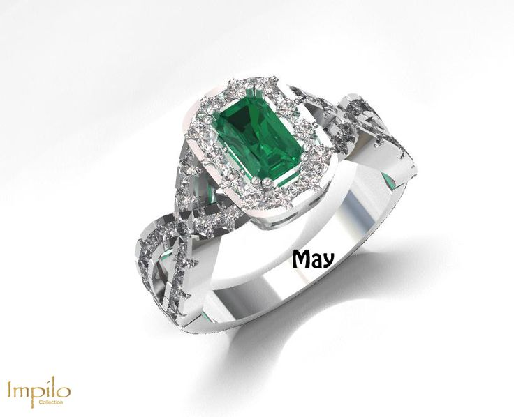 """May"" - Lovely green emerald centre stone surrounded by small diamonds in halo with smaller diamonds on each twisted shank. Symbolism of an emerald is loyalty, faithfulness and friendship."