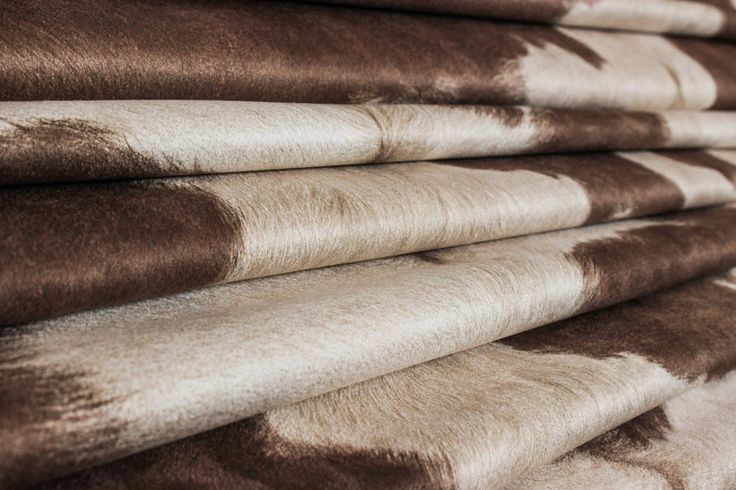 "Cowhide Brown/White. 54"" W. This is a stunning suede cow print that looks like an authentic hide with soft brown spots against a creamy background. The perfect fabric for any application. fabricmill.com"