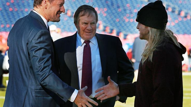Around three hours before kickoff, Patriots head coach Bill Belichick walks the field and checks out the conditions. As he left the field with his son Steve (right), a New England coaching assistant, they ran into Bill Cowher (left), the former Pittsburgh Steelers head coach and current TV analyst.