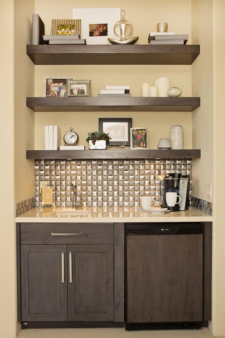 A Dark Wood Wet Bar In The Master Bedroom Is Compact And Adds Stylish  Convenience. The Metallic Backsplash Tiles Add Sheen And Chunky Shelves  Provide Space ...