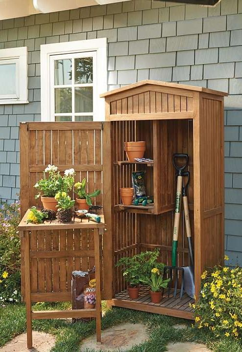 This charming storage cabinet keeps your short- and long-handled tools, potting supplies and other landscaping essentials close at hand while you work in your garden.Gardens Ideas, Diy Gardens, Storage Cabinets, Nice Ideas, All Weaths Teak, Charms Storage, Gardens Sh