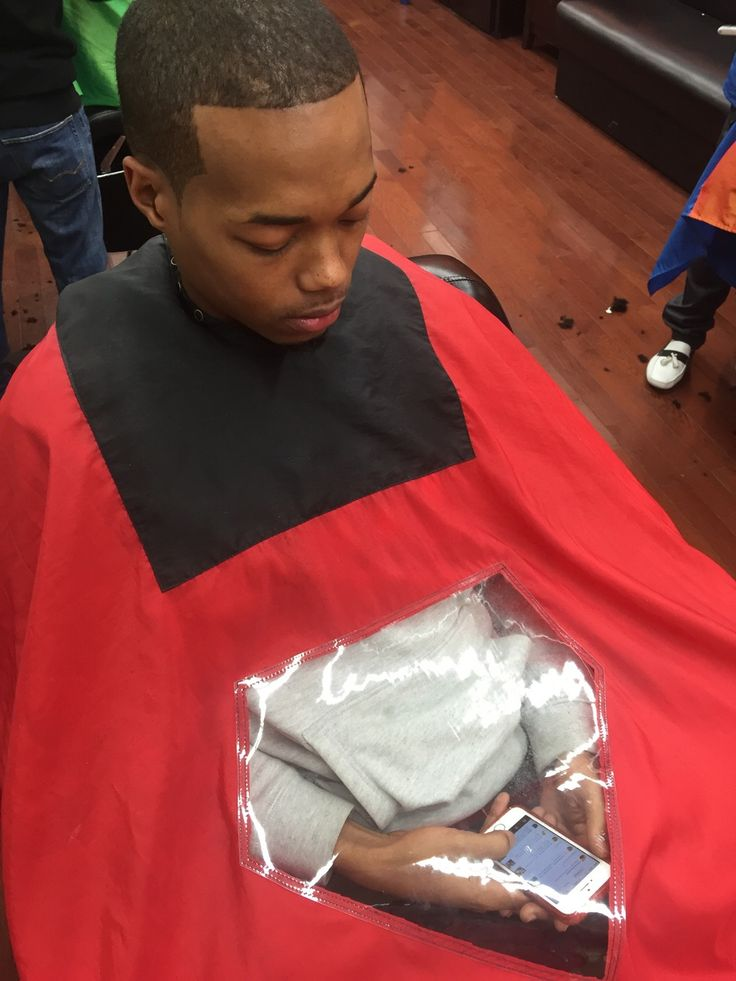 See-through barber cape. We tried a similar cape and it was great! Helped keep hair off of clothes and iPad.