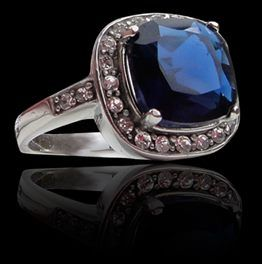 'Sea Star' Steel & Blue Stone Statement Ring. Cushion-cut glass stone in bright blue makes a stunning statement atop strong 316 steel casing. White CZ's highlight the center stone for a glamorous effect. And really, why not look a little bit fabulous everyday?  Available in sizes 6, 7, 8 and 9 - $24.00