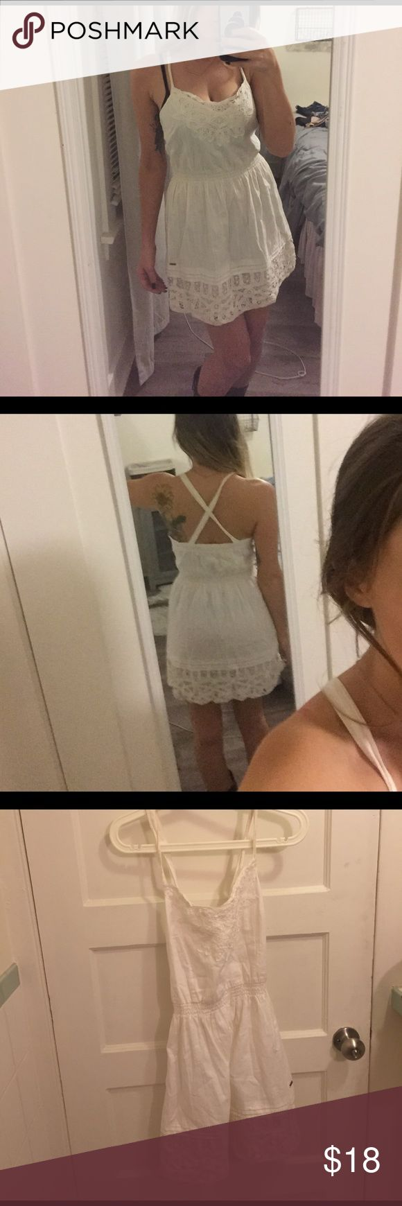 Lace Hollister Dress Really cute white lace dress from Hollister. Not see through at all. Cross back. Slight discoloration on straps but won't even show up in photo. Hollister Dresses