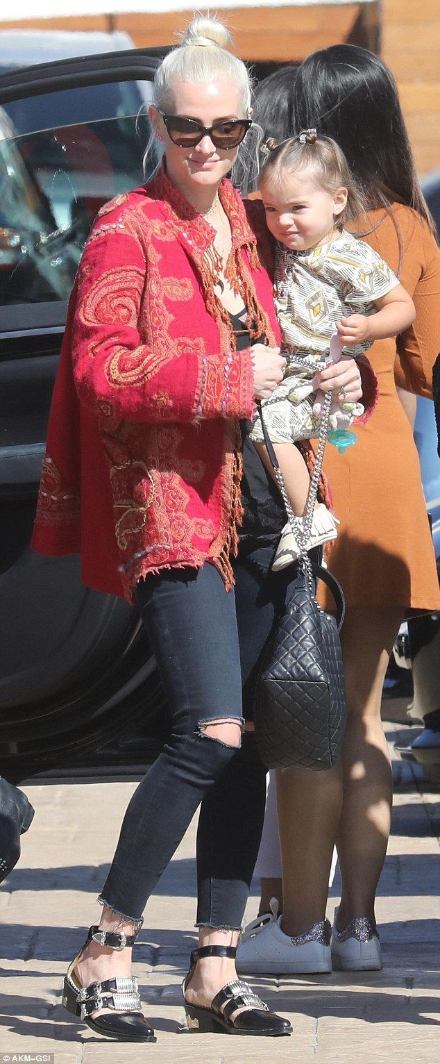 Family time: Ashlee Simpson showed off her adorable daughter Jagger as she arrived at Nobu Malibu on Tuesday for lunch wearing a red and gold patterned jacket over ripped black jeans