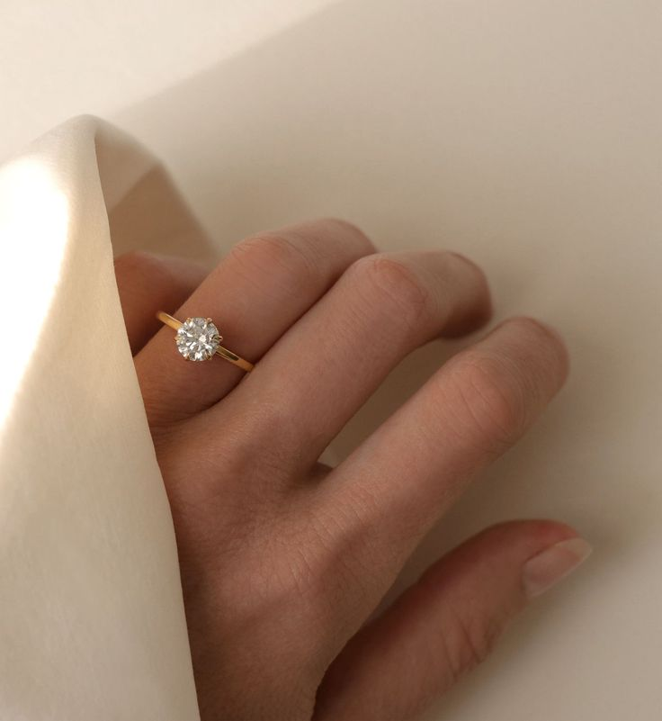 VOW: The modern solitaire diamond engagement ring. Thin band, conflict-free diamond, free home try-on.