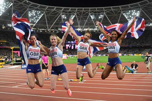 Zoey Clark, Laviai Nielsen, Eilidh Doyle and Emily Diamond celebrate winning silver in the Women's 4x400 Metres Relay at the 16th IAAF World Athletics Championships London 2017