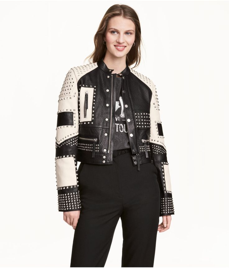 Black/white. PREMIUM QUALITY. Short leather jacket with studs and contrasting sections. Small stand-up collar and snap fasteners at front. Front pockets,
