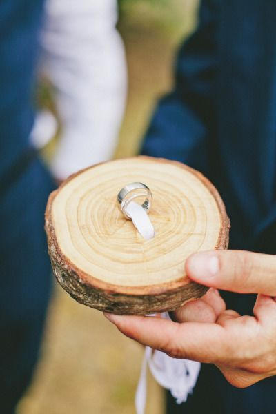"Attach ring(s) to a small tree slab as ringbearer's ""pillow"". Different!"