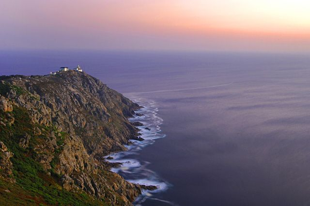 """Cape Finisterre( Galicia)  The End of the Pilgrims Way and almost most westerly point in Spain  Finisterre derived from the Latin """"Finis Terrae""""(The End of The Earth) for its location, a small finger of land into the Brave Atlantic Ocean  The view from the cape is shocking, above all at night.  Hundreds of years ago people believed the World ended somewhere there"""