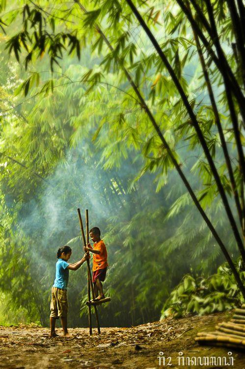 "Indonesian traditional game ""Enggrang"" made of bamboo."