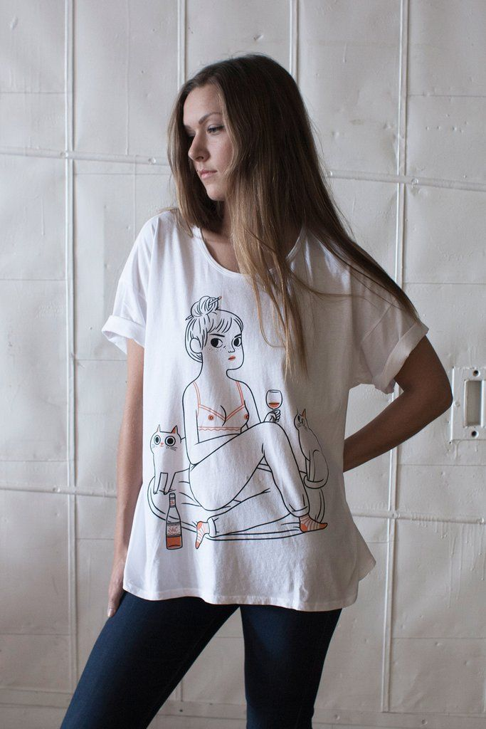 Our favourite kind of night in illustrated by Julia Bereciartu. Printed in black and peachy pink on a 100% cotton jersey loose tee. This is a one size fits most