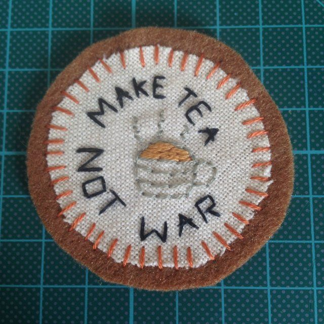 """""""Make tea not war"""" patch with pin on back ☕️ medium size, approx 5.5cm. Very cute for any tea lovers out there ☕️ £3.00 plus £1.00 p&p, remember with any patch, chokers become £1.25 and p&p is free ✨ ignore: #art #badge #cheap #choker #customorder #cute #embroidery #handmadepatch #handmade #jewellery #madetoorder #necklace #offer #oneofakind #patchgame #patch #ribbonchoker #sale #sewonpatch #unique #tea #maketeanotwar #quote #irononpatch #brooch"""