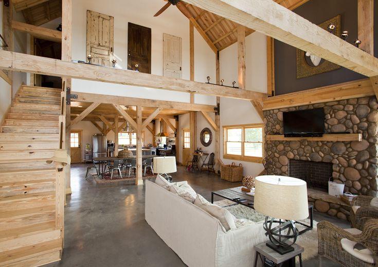 Open floor plan in a barn home with loft living space.  Wood post & beams add style!  www.sandcreekpostandbeam.com https://www.facebook.com/SandCreekPostandBeam