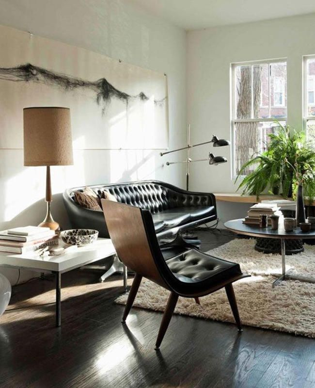 Love the rich leather sofa, dark flooring, and white walls in this room. Chair style is also attractive.| www.bocadolobo.com/ #livingroomideas #livingroomdecor