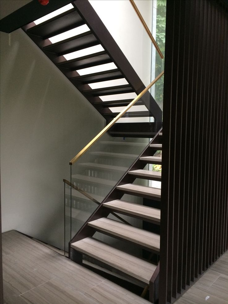 Brass handrail slotted over glass balustrade is very effective. Built and installed by #Culmax . Www.culmax.co.uk