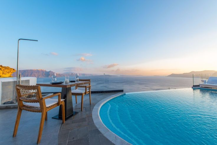 Have dinner by the pool at Santorini Secret Suites and Spa