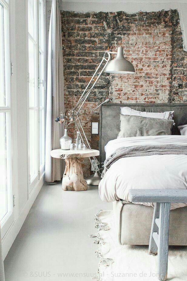 Beautiful rustic brick wall for a bedroom