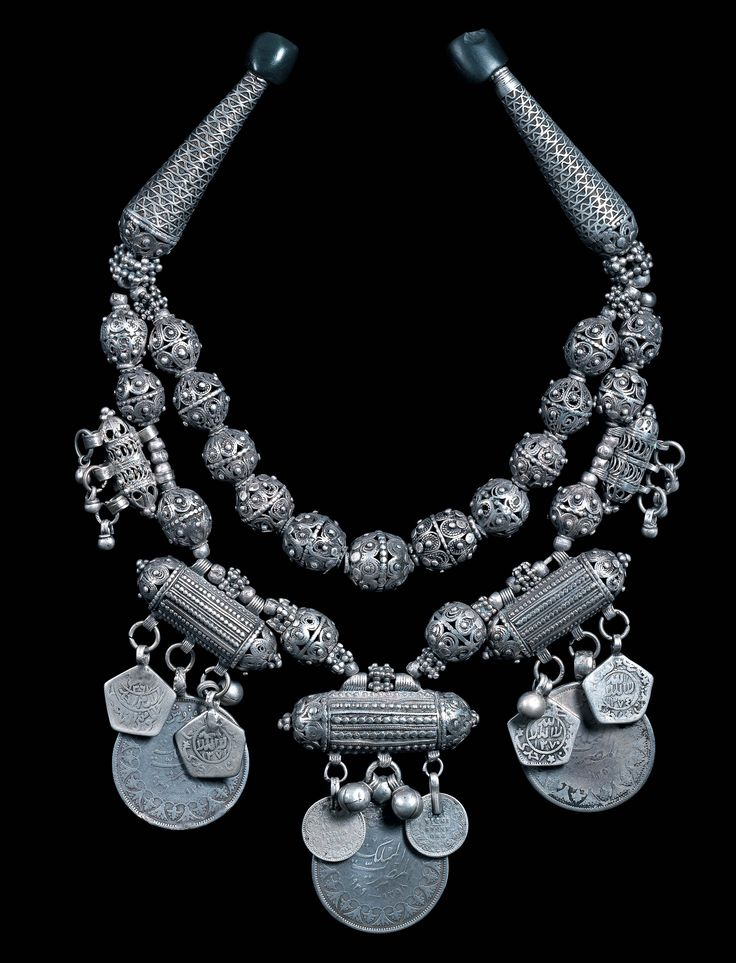 Double strand silver necklace with early granulated style beads, having small Kutub prayer containers, Ottoman coins and small rupee coins dated 1893. (archives sold Singkiang)