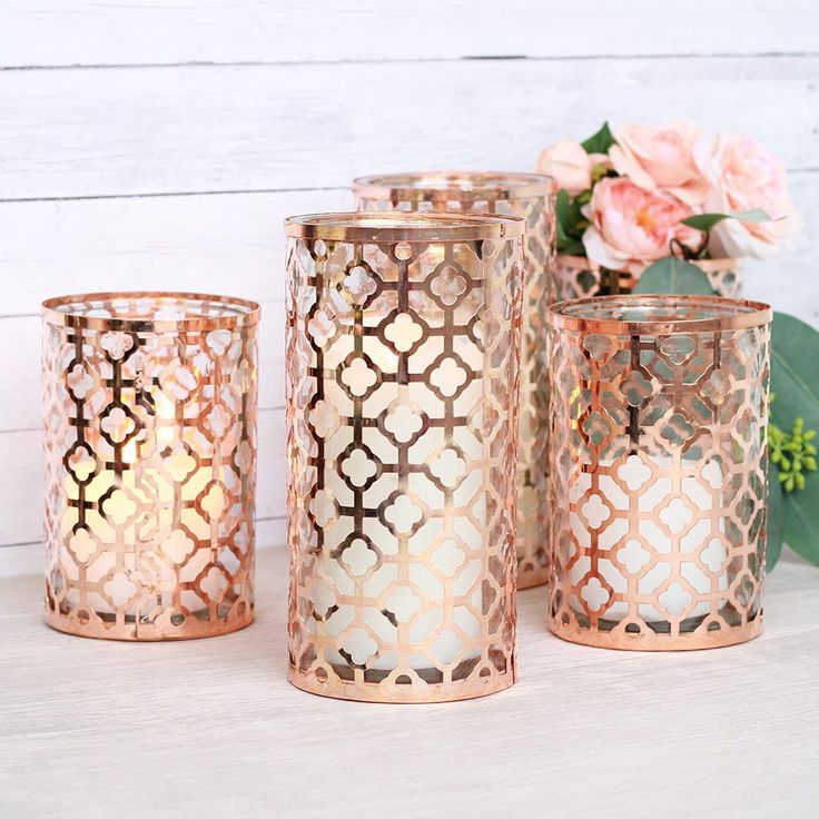 Find copper wedding decorations like this beautiful glass cylinder vase that has a decorative sleeve in copper with a keyhole design. Perfect for vintage or bohemian centerpieces, or create a Valentin