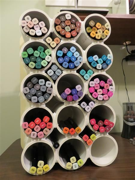 marker storage by Stampin'Bodz - Cards and Paper Crafts at Splitcoaststampers...great storage for all those pens, markers, tubes, etc.  This can be a DIY by hot gluing the plastic containers from protein shakes.