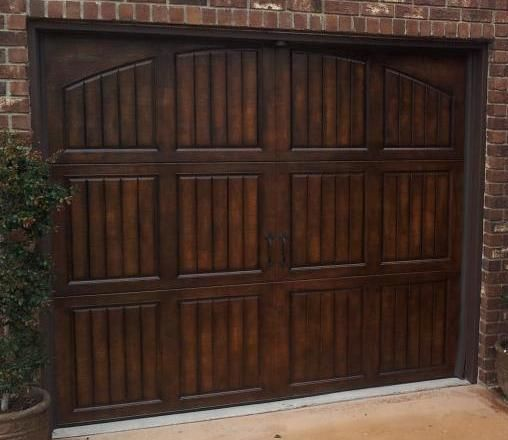 Faux Garage Doors, make a metal garage door look like wood. would love this. too bad they are on the other side of the country :(