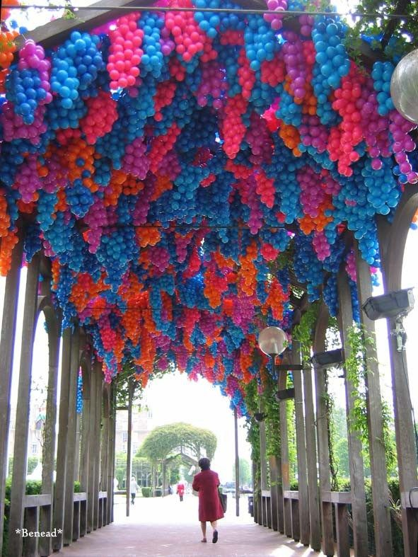 Urban installation by 90,000 plastic balls shaping wisterias, a flowering plant that has a significant role in French impressionism through its recurrence in Monet's paintings,  Havre City Hall, France | The installation, titled Pergola, was designed by Claude Cormier + Associés Inc. for the Contemporary Art Biennale.