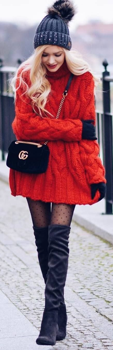 #winter #outfits orange loose sweater dress, long black boots, hat, suede bag