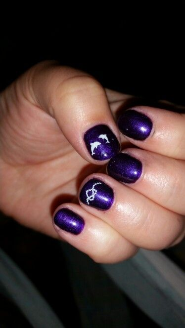 Purple dolphin nails.