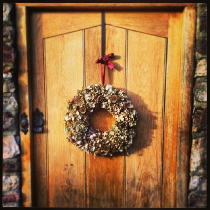 Hydrangea wreath with teasels and pine cones