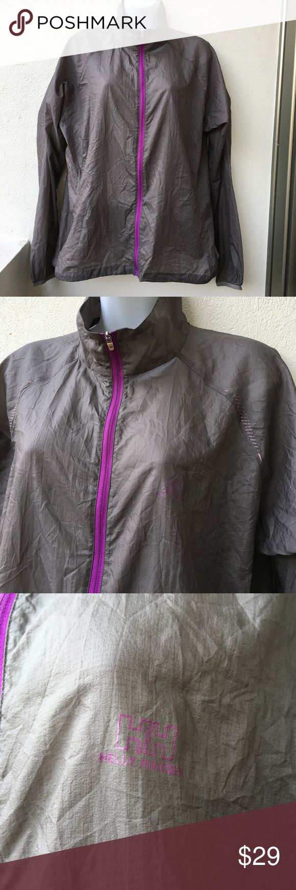 Helly Hansen Windbreaker zip up Jacket size XL Preowned authentic Helly Hansen Women's Sheer Gray Windbreaker full zip up Jacket size XL. Please look at pictures for better reference. Happy shopping! Helly Hansen Jackets & Coats