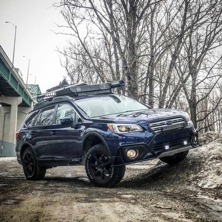 "Make: Subaru Model: Outback 2.5i groupe Tourisme / Option Ensemble TechnologieYear: 2016 Color: Bleu lapis nacré Modifications: Tires: 245/65R17 BFGoodrich All Terrain T/A KO2 Wheels: Fast Wheels FC-01 17x8+40 Lift kit: 2"" LP Aventure Skid plate: LP Aventure Bumper Guard: LP Aventure LED bar: RTXline Cargo basket: Yakima Load Warrior + Extension + Spare Tire Carrier Bike Rack: Yakima Boa Awning: ARB Awning 2000"