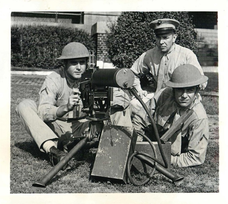 1941- Members of the Marine officer training school at at Philadelphia's Navy Yard shown with machine gun. All are former football players.