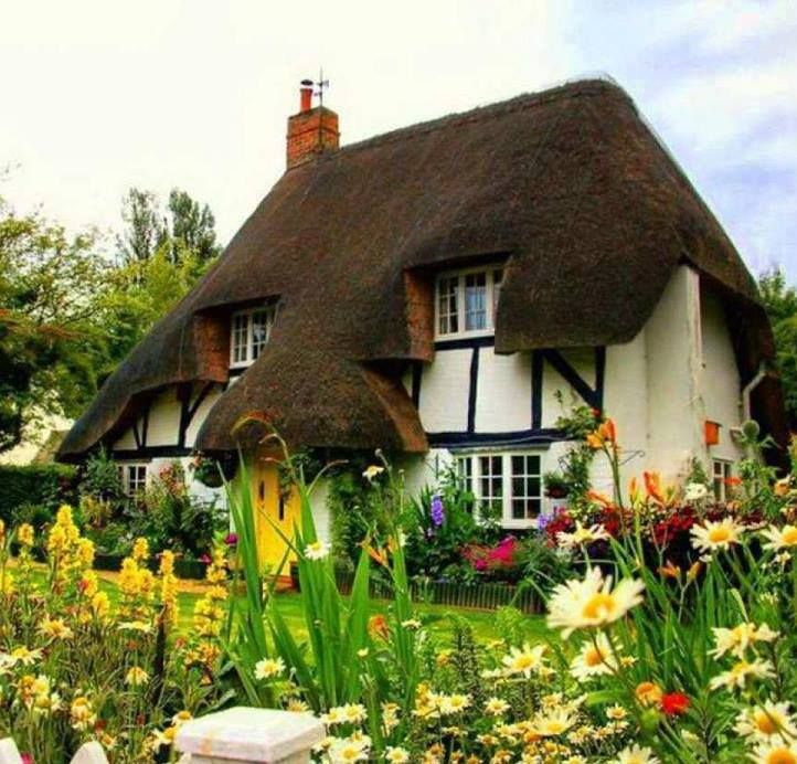 English home with thatched roof