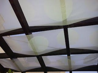Panel curtains woven through a pergola to create shade. Perfect! IKEA Hackers: Slightly Shadowy